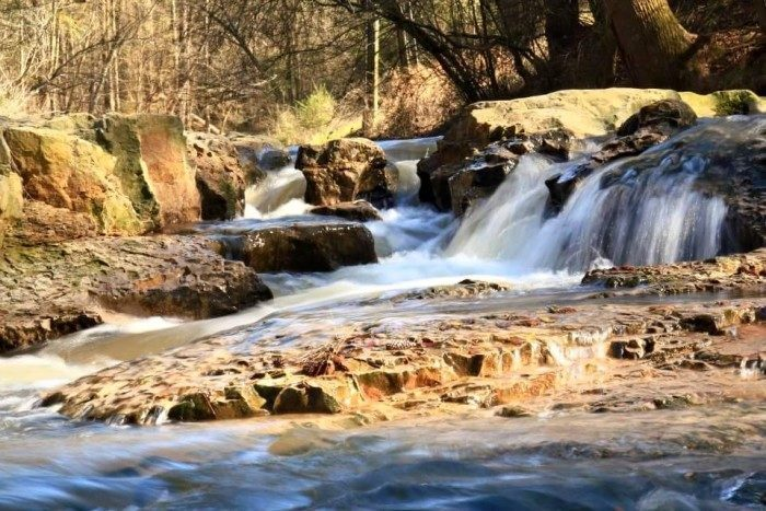 The secluded water park features a small waterfall, sand and rock creek-side beach, and an old-fashioned swimming hole.
