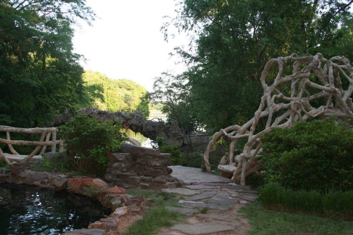 In T.R. Pugh Memorial Park, you'll find that the trail that leads you around this unforgettable place is surrounded by unique bridges made from twisted branches.