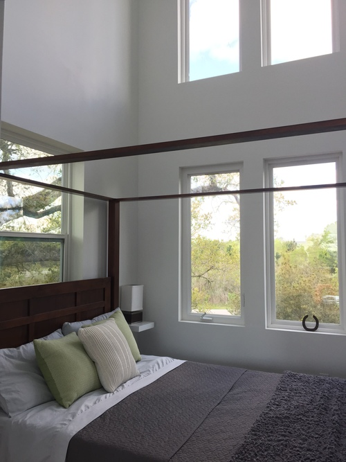 Thanks to plenty of windows and 19' ceilings, the bedroom feels completely open.