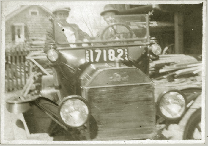 Check out these two men in a Ford Model T!
