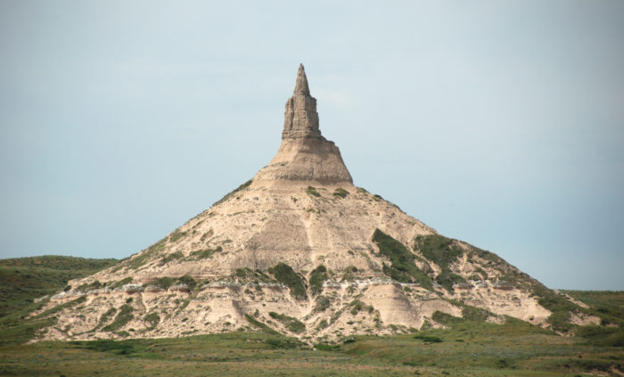 7. Not long after that, you'll see Chimney Rock rising above the plains, just like the pioneers did. Again, there will be signs to guide you to the formation if you want to see it up close.