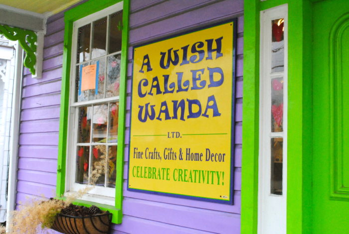 Several of the shops are whimsically painted with pops of pastel.