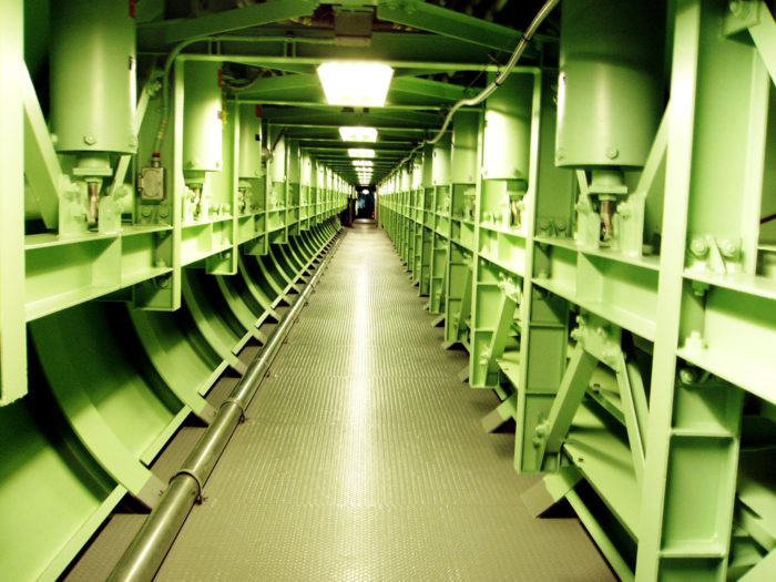The silo extends 140 feet into the earth, and is composed of eight levels: two levels are the control center, and the other six are dedicated to housing the missile and other equipment.