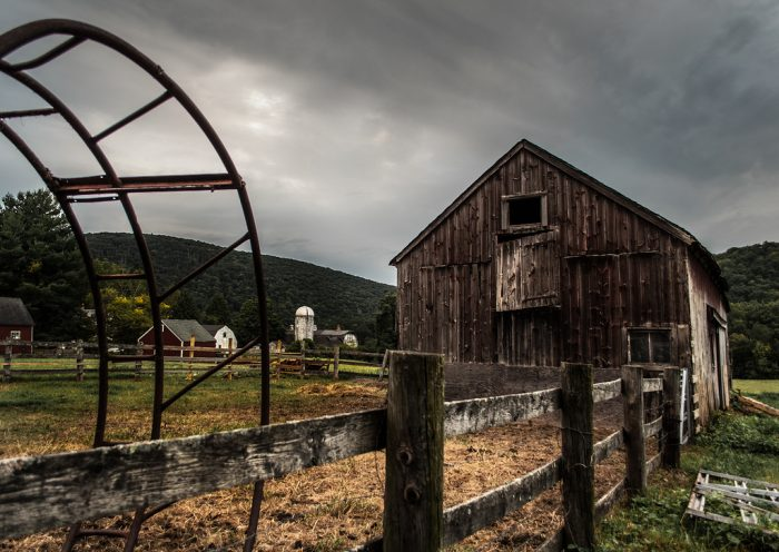 8. This barn in Kent has weathered many storms, but it and the fence are still standing!