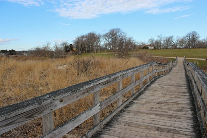 The land includes a short but well-maintained boardwalk that connects the grounds to the beach.