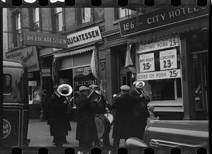 7. A Yorkville street band entertaining all those who walk by, imagine the music they were playing in 1937! Music was one of the small ways Americans could take their mind off of all that was going on during the 1930s.
