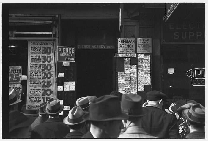 1. New Yorkers lined up outside of an employment agency in 1937. With unemployment at an all time high, this picture was a familiar setting during The Great Depression.