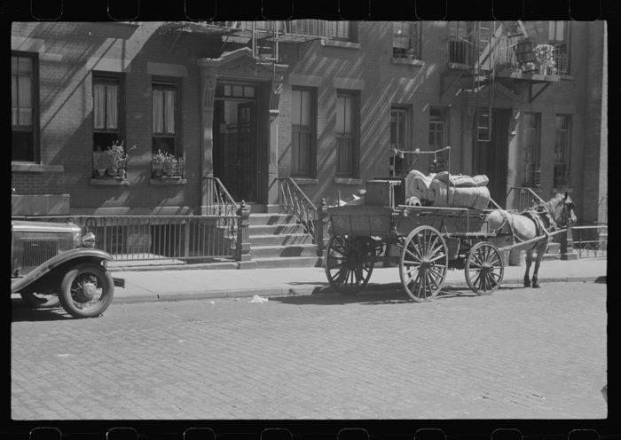 12. Can you imagine using this horse-drawn wagon as your moving truck in modern times? Taken in 1938, you can see a New Yorker moving out of their apartment.