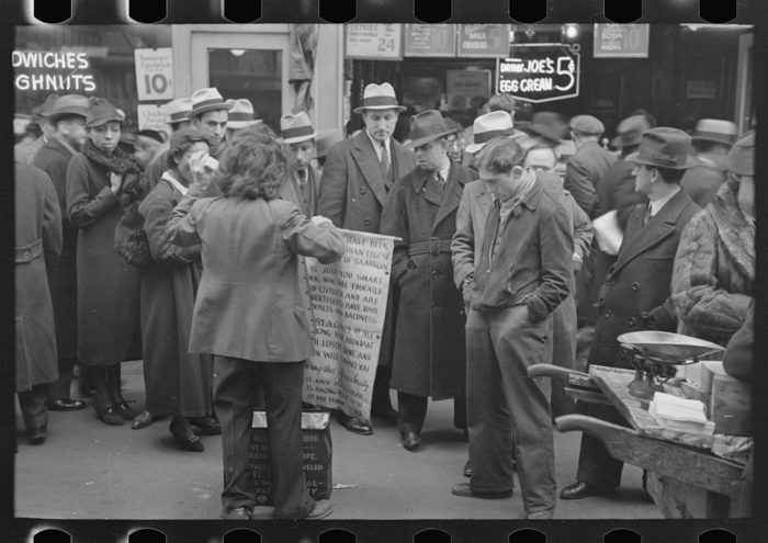 4. A New York City salesman attracting a large crowd of New Yorkers in 1936, doing whatever he can to make money during these hard times.