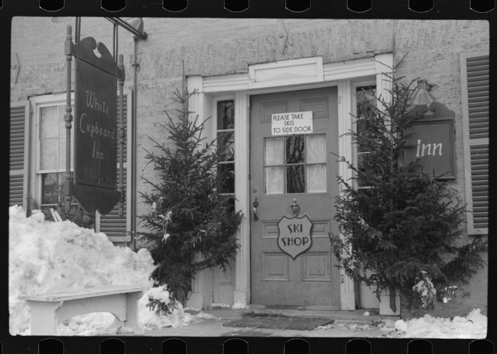 10.  Front door of white Cupboard Inn, old home converted into tavern for winter and summer visitors in Woodstock.