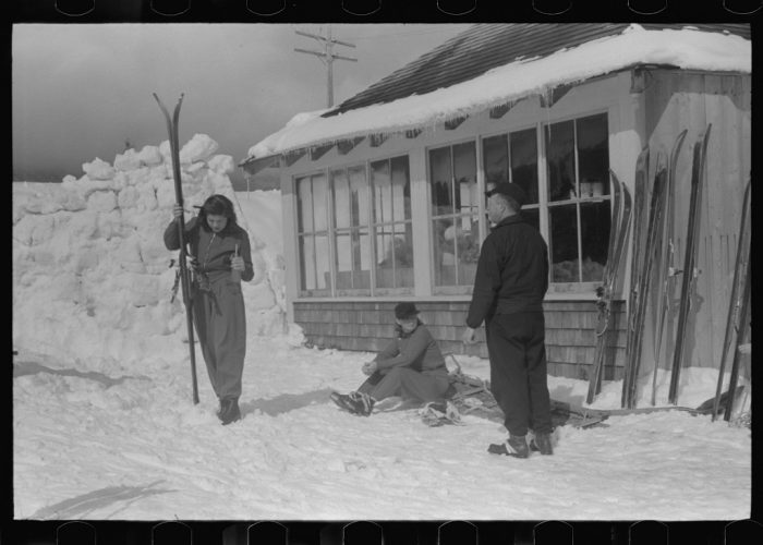 12.  Skiers during noon hour outside of toll house at the foot of Mount Mansfield, Smugglers Notch.