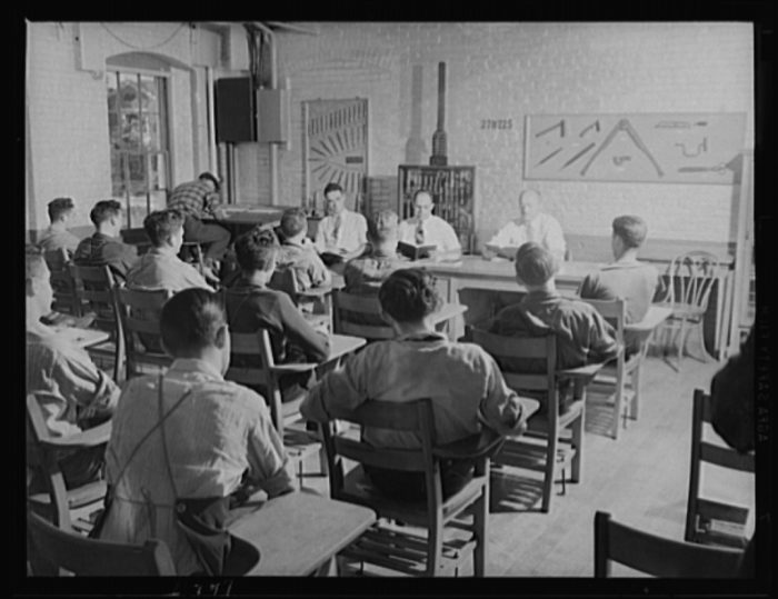5. These boys in 1940 are part of their school's war production program.