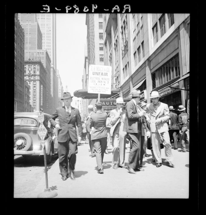 8. New Yorkers and Union protesters walking along the streets of New York City in 1936.
