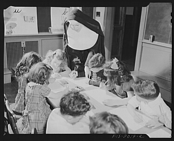 11. Instructing young students in handwriting and penmanship at a Roman Catholic school in New Bedford, 1942.