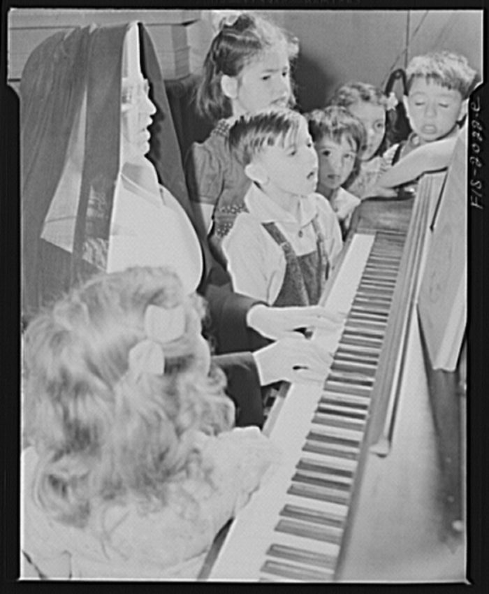 13. Singing hymns in class was once a fairly common activity. This scene is from a Roman Catholic school in New Bedford, 1942.