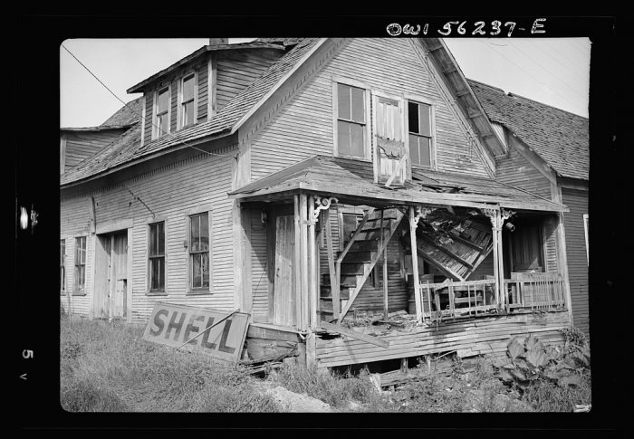 16.  A farmhouse in West Danville with stairway leading to the second floor through the porch roof