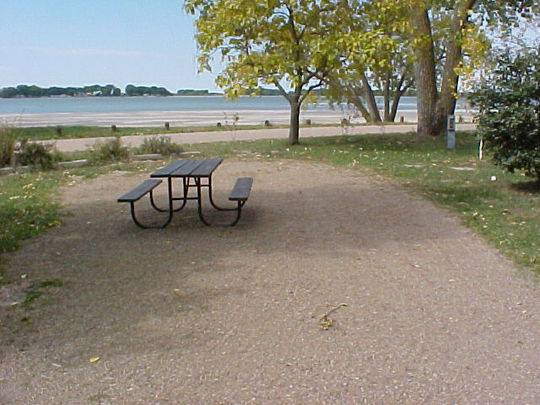 All of the camp sites have access to the beautiful green grounds, picnic shelters, 133 grills, and the public swimming beach.