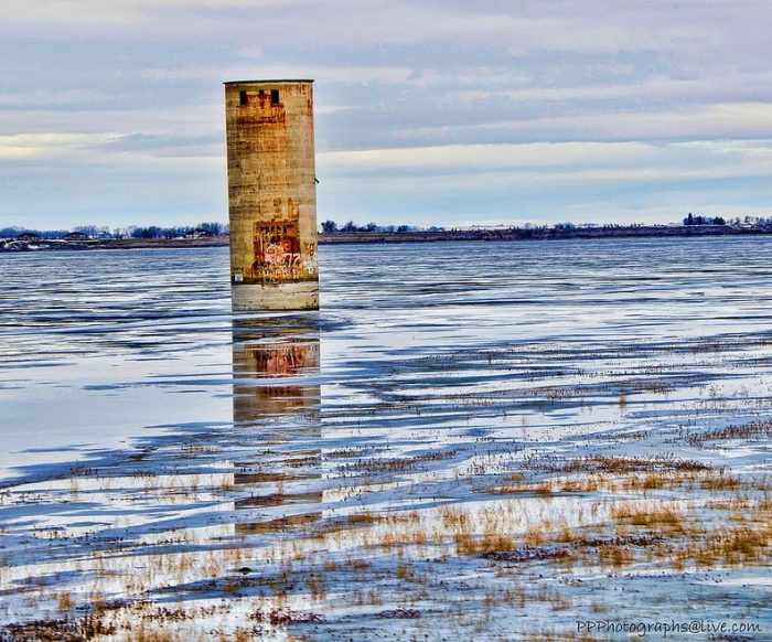 Only the Oneida grain elevator remains in its original location, standing proudly above the water as a silent reminder of the historic marvels that remain hidden beneath the surface.