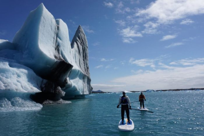6. Go stand up paddleboarding around huge glaciers.