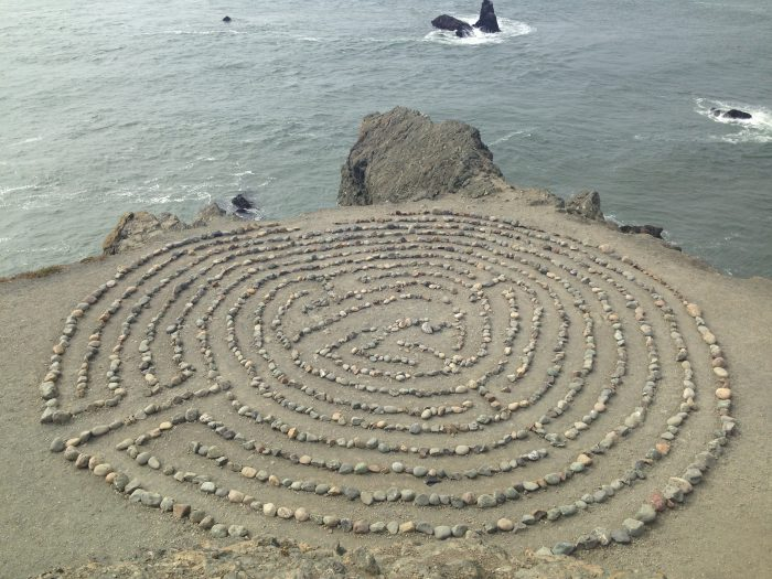 Head up the small, rocky cliff to the top and look down… labyrinth!
