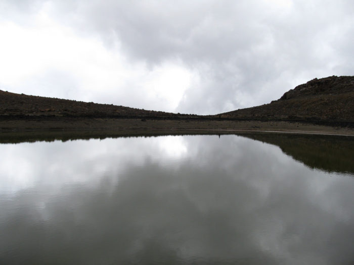 Located within the Pu'u Waiau cinder cone, the lake is only fed precipitation - which occurs primarily during the winter months - and has a catchment area of more than 130,000 meters.