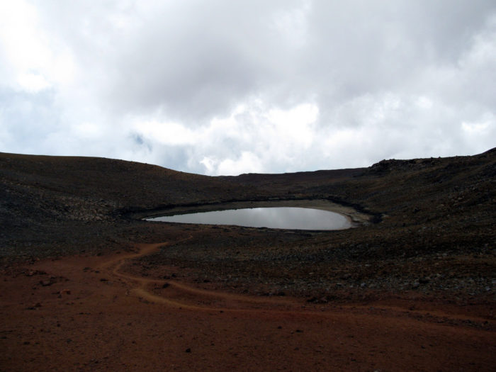 And while it may not seem as though this small lake has any significance, it is quite the anomaly. You see, nowhere else in the summit area of Mauna Kea is the ground able to retain water. The exact nature of the  impenetrable ground layer beneath the lake is still unknown, though it is assumed that fine-grained, densely-compressed ash, a small permafrost layer, or basalt rock, may be behind the strange lake.