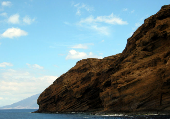 Rising approximately 300 feet from the ocean's surface, Molokini is a half mile wide, and peaks at approximately 160 feet.