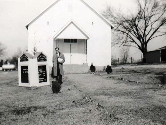 Paul-Rogers-standing-beside-the-original-Old-Jefferson-Church-of-Christ-1953