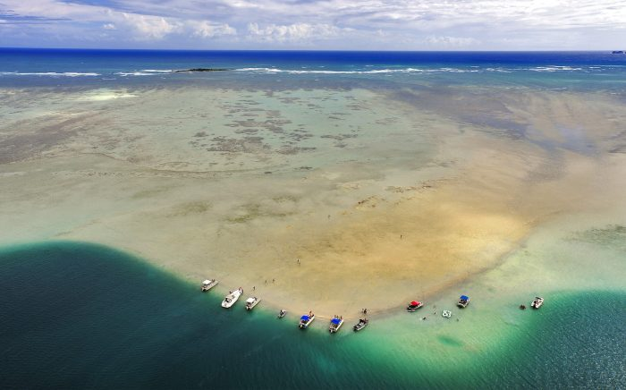This beautiful strip of sand lies a few hundred yards off the coast, and is almost at sea level, so during periods of low tide, you could be standing in just a few inches of water.