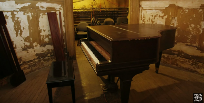 In 1942, the theatre closed due to new fire codes. Today, it is piled with unused and broken pianos.