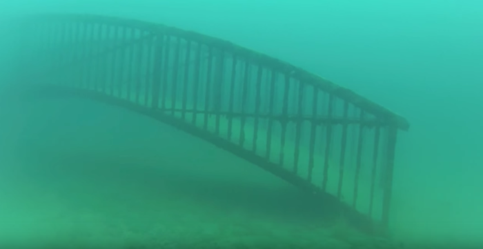Besides the weapon of mass destruction, the bottom of the quarry is an eerie landscape of sunken bridges and shimmering algae.