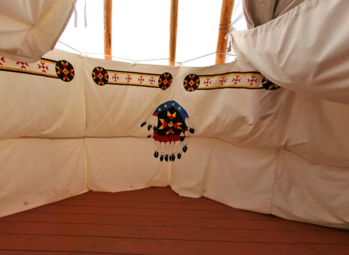 The inside is spacious enough for 6 to sleep comfortably with cots or sleeping bag pads.