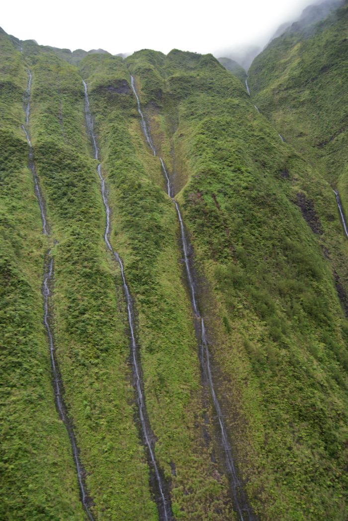 Taking a helicopter tour on Kauai is perhaps the most popular way to experience the waterfalls - and pilots have been known to hover near the base of the falls to give you a closer look.