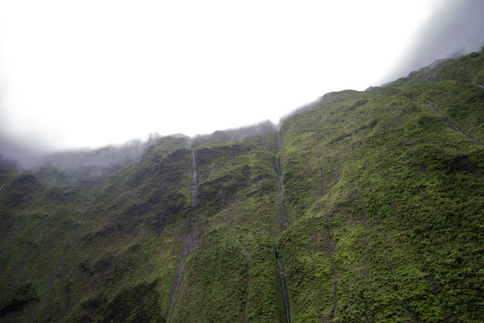 Mount Waialeale is the second wettest spot on earth, receiving a staggering 450 inches of rain each year, and is almost always shrouded in clouds. As a matter of fact, the summit only peeks through the clouds approximately 20 days each year.
