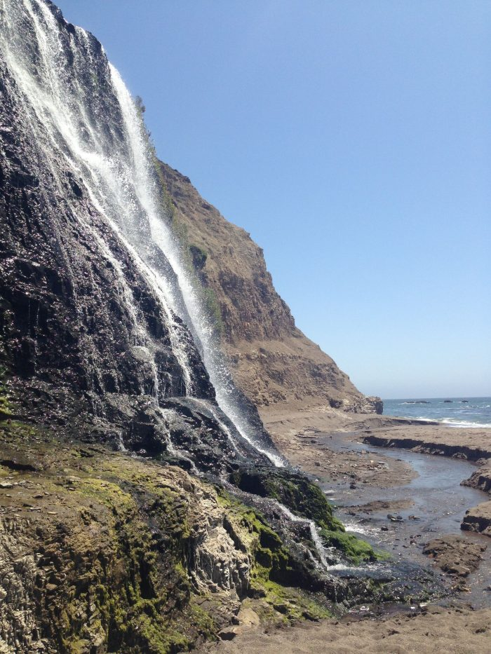 Once you've reached the beach, you'll get a spectacular view of the 40-foot falls as they flow down through the beach and into the Pacific.