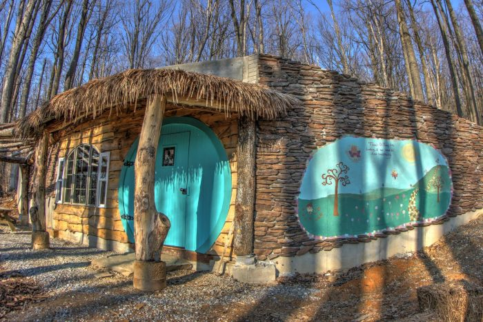 The outside of this special structure sets the tone for your magical stay. There is a thatch covered porch, outdoor fire circle, grill, and picnic table.