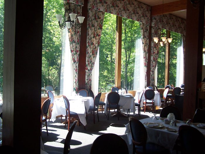 The dining room has large windows, perfect for viewing the scenery while you eat.