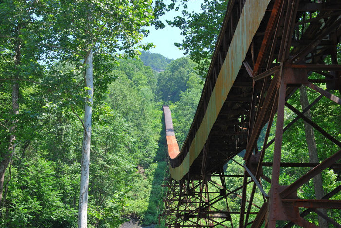 The trail passes under an old mine conveyor.