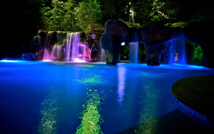 The swimming pool has a large grotto and natural boulder waterfalls.