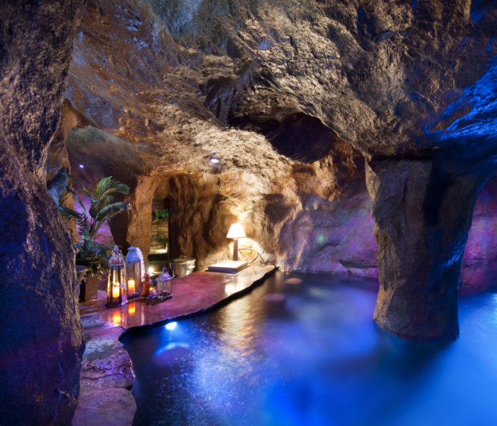 A swim-up bar can be found inside the grotto.