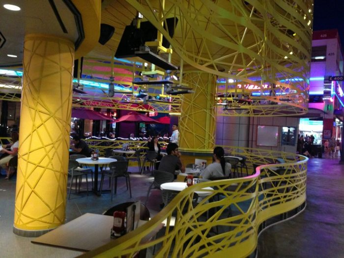 After a ceremony, the wedding party and guests enjoy the ambience of a uniquely designed Denny's on Fremont Street