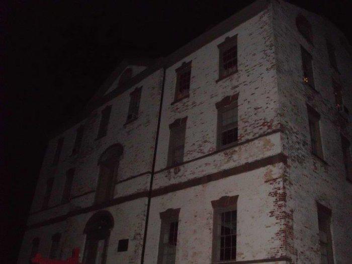 Proprietary House at night.