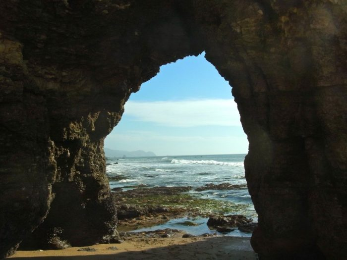 Once you've arrived to the aptly named Sculptured Beach, you'll know it. Look for beautifully sculpted rocks, arches, and caves along the beach.