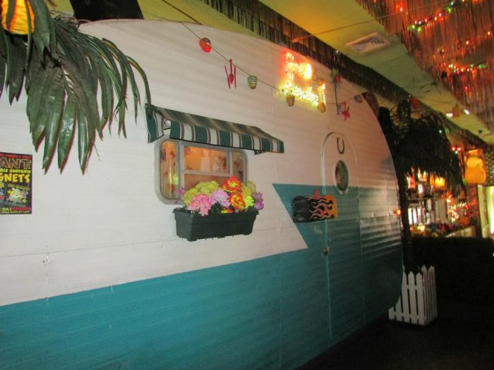No that's not a mural on the wall, you'll find an actual trailer in the restaurant!