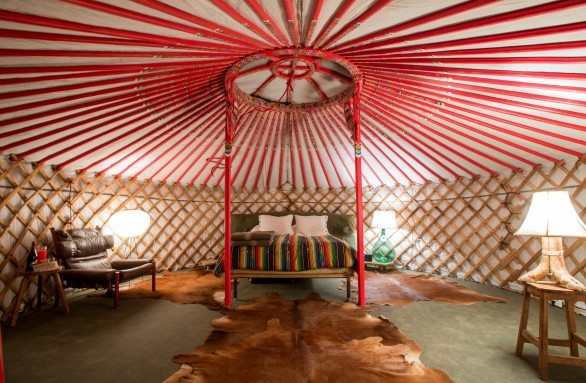 You can stay in a quirky Mongolian Yurt at El Cosmico...(more info on that here.)