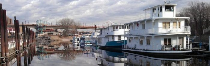 The Inn permanently sits moored by downtown St. Paul. It originally pushed barges of liquid cargo along a 1,000-mile stretch of the Ohio and Mississippi Rivers, but was transformed and opened in 1995 as The Covington Inn.