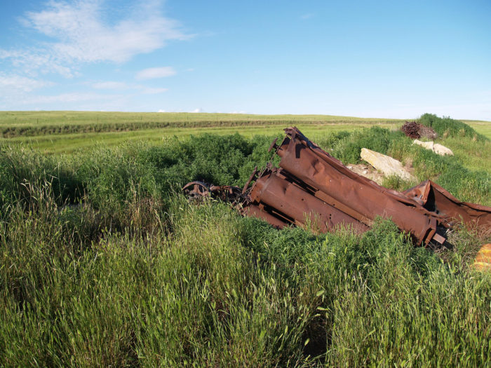 2. Petrel, North Dakota is not much more than fields and scrap heaps today. In 1960, 65 people still called it home.