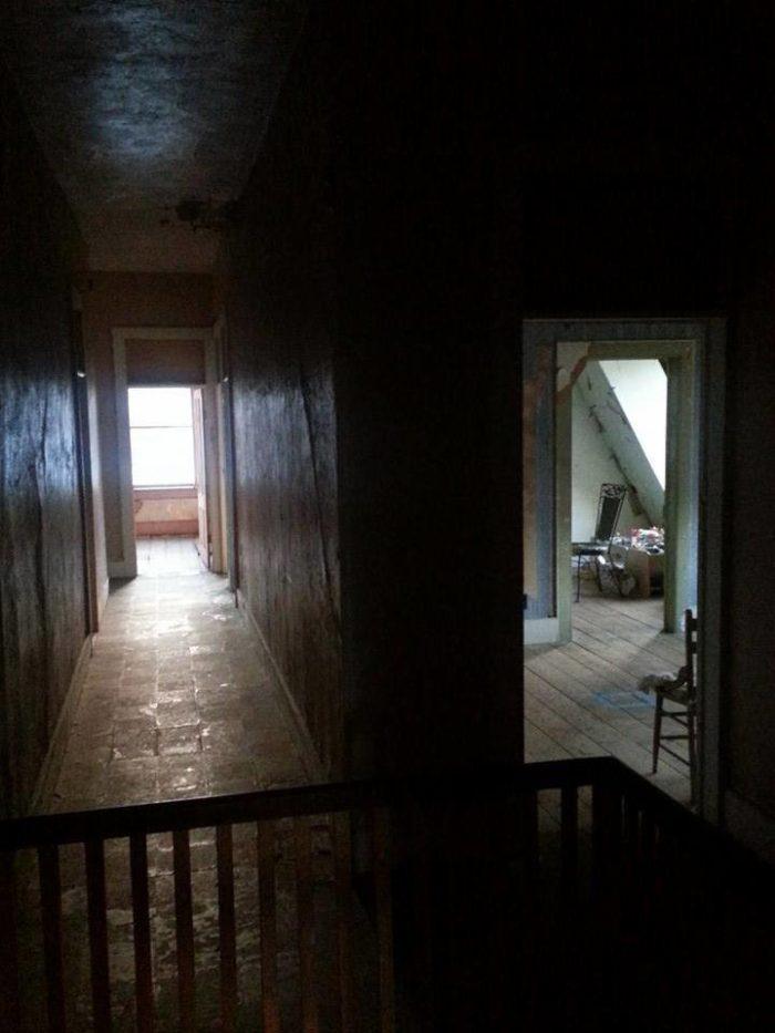This third-floor hallway is also haunted.
