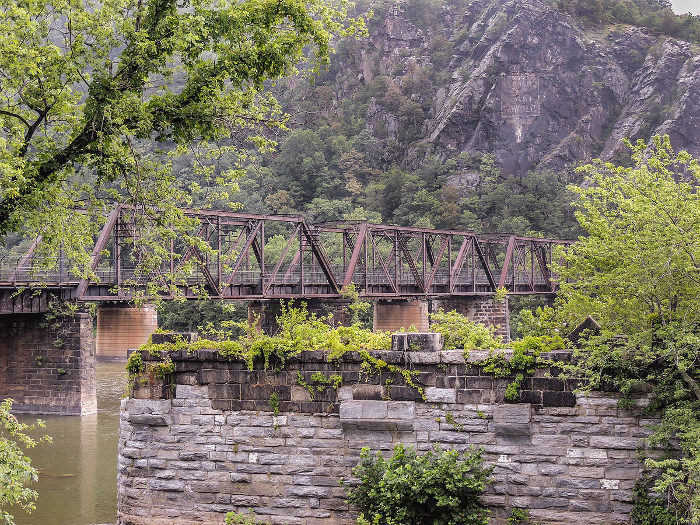 Harpers Ferry ends at the Potomac River, where an old railroad  leads to the state of Maryland.