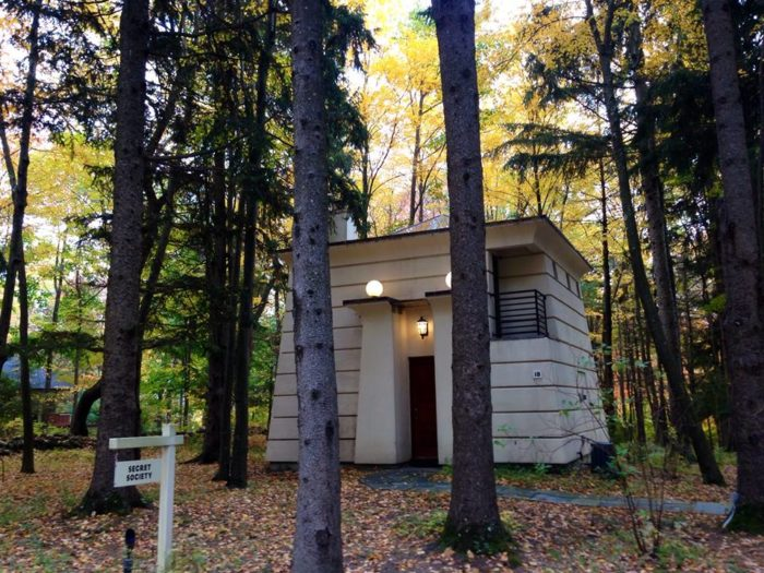 This 800-square-foot cottage tucked into the woods is known as the Secret Society.